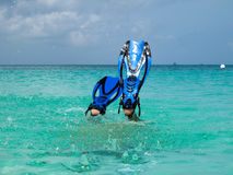 Diver descending. Into crystall clear water Royalty Free Stock Images