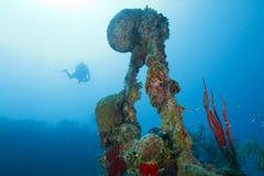 Diver Descending Toward Shipwreck Scaffolding. Roatan, Honduras Stock Image
