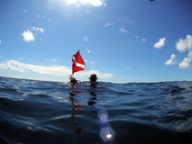Diver with dive flag. Diver at the surface after a dive on Turtle Ledge reef in about 55 feet of water. Off the coast of south Florida stock photography