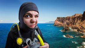 Diver in diving gear, ocean on background royalty free stock photos