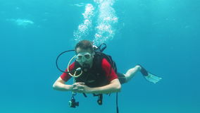 Diver diving hand shows sign okay stock video footage