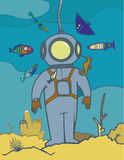 Diver in diving suit. Diver dressed in this diving-suit stopped at the back of the sea, and fish look at it Stock Images