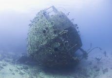 Diver exploring a large shipwreck Royalty Free Stock Photos