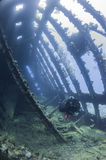 Diver exploring a large shipwreck stock photos