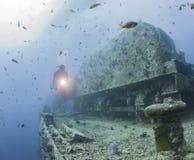 Diver exploring a large shipwreck Stock Photos
