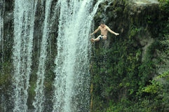 Diver in fly on international extreme diving competition. In Bosnia, waterfall place jajce Royalty Free Stock Image