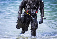 Diver getting out of water Stock Photography