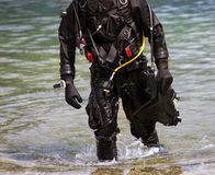Diver getting out of water Stock Images