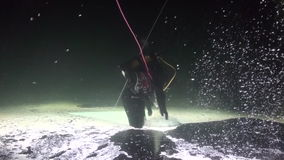 Diver goes on ice underwater of White Sea. stock video footage