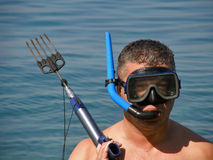 Diver with harpoon. One wet diver with diving mask and harpoon on cyan blue Adriatic sea. (Dalmatia-Croatia) .Horizontal color photo Stock Photo