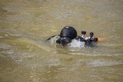 Diver head with scuba set. Working on removing river hazards Stock Photo