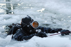 Diver among the ice. Diver rising on the surface between the ice Royalty Free Stock Images