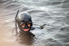 Diver man with mask in water. Diver man with mask in the water Stock Image