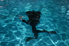 Diver moving underwater Royalty Free Stock Photos