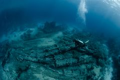 Diver over Underwater wreckage Royalty Free Stock Image
