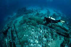 Diver Over Underwater Wreckage Stock Photo