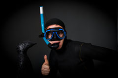 Diver and penguin in antarctica. Indoor shot royalty free stock photography