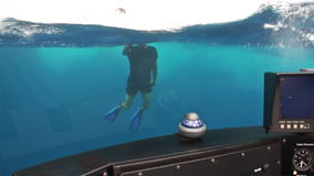 Diver photographs the submarine under water in Pacific Ocean. Inside view. stock footage