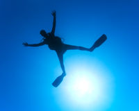 Scuba Diver underwater with spread arms and legs Royalty Free Stock Photography