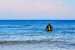 Diver prepare for the dive. Scuba diver preparing to dive into sea Royalty Free Stock Photos