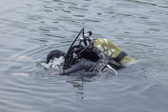 Diver on the river with equipment Stock Photo