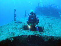 Diver in shipwreck royalty free stock photo