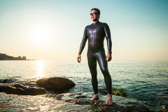 Diver standing in sea waves Stock Photo