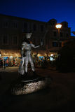 Diver statue in Mali Losinj,Croatia. Bronze diver statue holding fishing spear in Mali Losinj,Croatia in the night time Stock Images