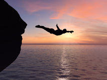 Diver and sunset. Silhouette of a diver in sunset royalty free stock photos
