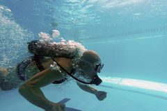Diver in Swimming pool, Scuba Dive Swimming Pool. Underwater royalty free stock photos