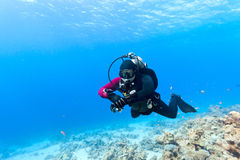 Diver swimming under water. Male scuba diver swimming under water Royalty Free Stock Photography
