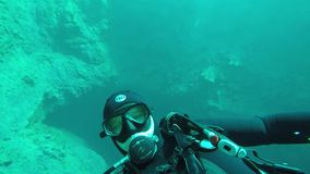 The diver swims under water. In the lake stock footage