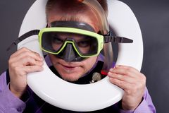 Diver in toilet Stock Photography