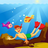 Diver underwater. Cheerful diver swims under water with the fishes Royalty Free Stock Photography