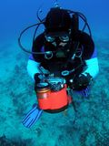 Diver with underwater Camera. This diver was adjusting his camera settings at 50 feet. We were diving the Abby Too reef in Pompano Beach, Florida stock photo