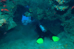 Diver in underwater cave, Indian ocean Royalty Free Stock Photos