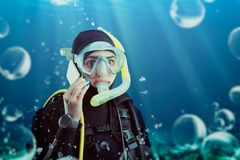 Diver in wetsuit and diving gear, underwater view royalty free stock image