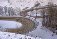Divergent road bends in the winter landscape stock photo