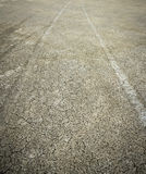 Diverging pattern of four wheel drive tracks in wet yellow sand Stock Image