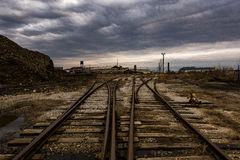 Diverging Railroad Tracks at Abandoned Foundry. A moody, evening view of an abandoned foundry now being demolished in Columbus, Ohio Stock Photos