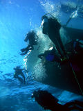 Divers. Returning to the boat after dive royalty free stock photography
