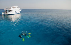 Divers and boat in the Red Sea Stock Images