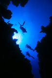 Divers and Canyon Stock Photos