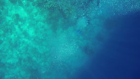 Divers deep in sea water with big air bubbles flowing stock video footage