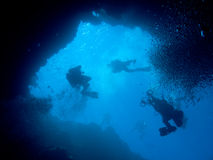 Divers Descending. Into Palau's Blue Hole royalty free stock photography