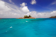 Divers dream. St. Pierre rocky island near the North coast of Praslin, Seychelles royalty free stock image