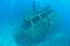 Divers exploring a large shipwreck Royalty Free Stock Photography