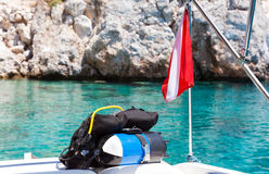 Divers flag with scuba diving equipment boat Royalty Free Stock Photography