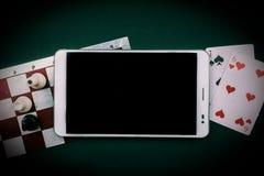 Divers jeux de société avec le PC de comprimé Photographie stock libre de droits
