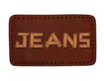 Divers labels de jeans avec des jeans de mot faits à partir du cuir Image libre de droits